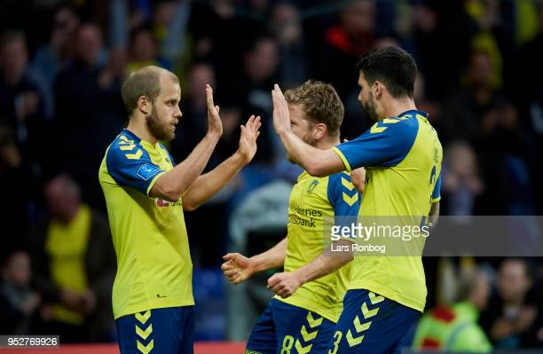 Teemu Pukki Kasper Fisker and Anthony Jung of Brondby IF celebrate after scoring their third goal during the Danish Alka Superliga match between...