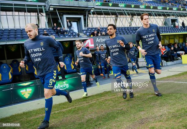 Teemu Pukki Kasper Fisker Hany Mukhtar and Benedikt Rocker of Brondby IF running on to the pitch with shirts in support for an injured Jan Kliment of...