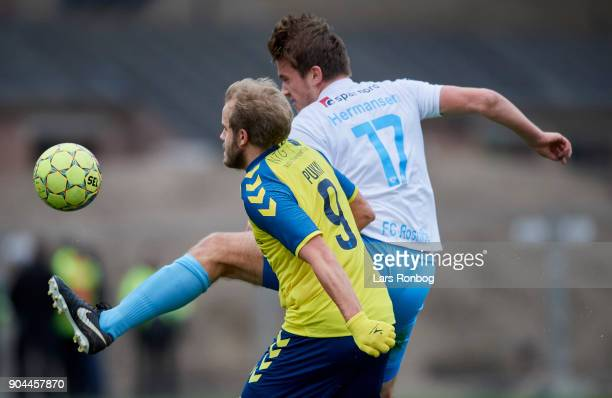 Teemu Pukki of Brondby IF and Andreas Hermansen of FC Roskilde compete for the ball during the test match Brondby IF vs FC Roskilde at Brondby...