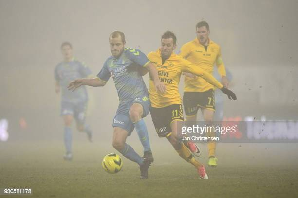 Teemu Pukki of Brondby IF and Peter Nymann of AC Horsens compete for the ball during the Danish Alka Superliga match between AC Horsens and Brondby...