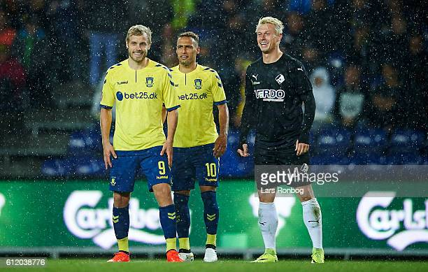 Teemu Pukki of Brondby IF Hany Mukhtar of Brondby IF and Marvin Pourie of Randers FC share a joke during halftime in the Danish Alka Superliga match...