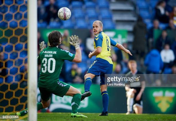 Teemu Pukki of Brondby IF scores the 40 goal against Goalkeeper Marcus Bobjerg of AC Horsens during the Danish Alka Superliga match between Brondby...