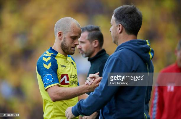 Teemu Pukki of Brondby IF shale hands with Alexander Zorniger head coach of Brondby IF during the Danish Alka Superliga match between Brondby IF and...
