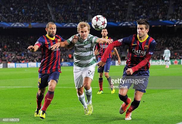 Teemu Pukki of Celtic FC gets between Gerard Pique and Javier Mascherano of FC Barcelona battles for the ball against during the UEFA Champions...