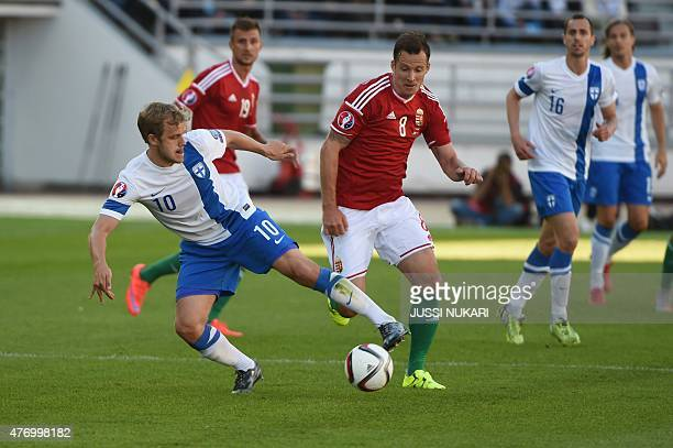 Teemu Pukki of Finland and Daniel Tozser of Hungary vie for the ball during the UEFA Euro 2016 Group F qualifying football match Finland vs Hungary...
