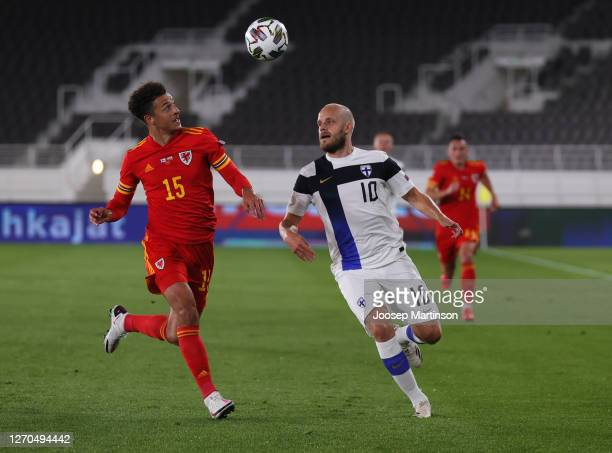 Teemu Pukki of Finland and Ethan Ampadu of Wales compete for the ball during the UEFA Nations League group stage match between Finland and Wales at...