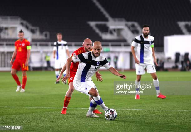 Teemu Pukki of Finland battles for possession with Jonny Williams of Wales during the UEFA Nations League group stage match between Finland and Wales...
