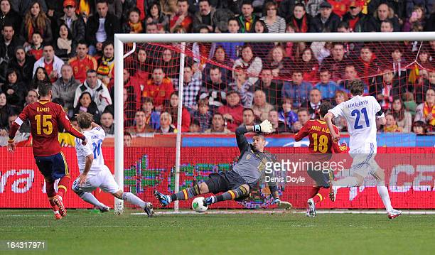 Teemu Pukki of Finland beats Victor Valdes of Spain to score Finland's opening goal during the FIFA 2014 World Cup Qualifier between Spain and...