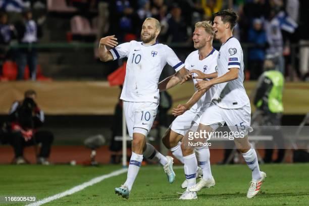 Teemu Pukki of Finland celebrates his goal with Paulus Arajuuri and Sauli Vaisanen during UEFA Euro 2020 qualifying match between Finland and Italy...