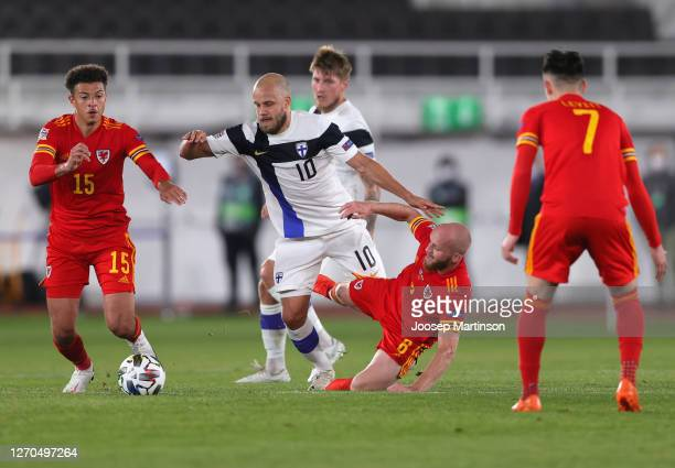 Teemu Pukki of Finland is challenged by Jonny Williams of Wales and Ethan Ampadu of Wales during the UEFA Nations League group stage match between...