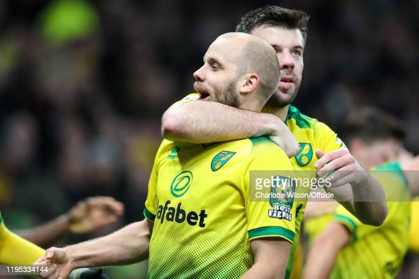 Teemu Pukki of Norwich celebrates scoring their 1st goal from the penalty spot with captain Grant Hanley during the Premier League match between...