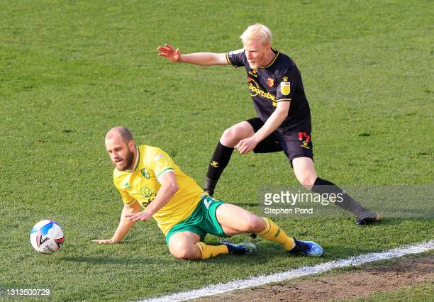 Teemu Pukki of Norwich City and Will Hughes of Watford FC battle for the ball during the Sky Bet Championship match between Norwich City and Watford...