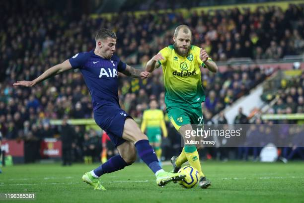 Teemu Pukki of Norwich City battles for possession with Toby Alderweireld of Tottenham Hotspur who shoots to Serge Aurier of Tottenham Hotspur who...