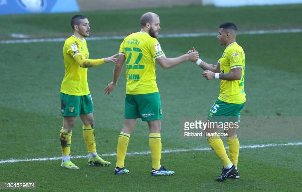 Teemu Pukki of Norwich City celebrates with Emi Buendia and Onel Hernandez after scoring their team's first goal during the Sky Bet Championship...
