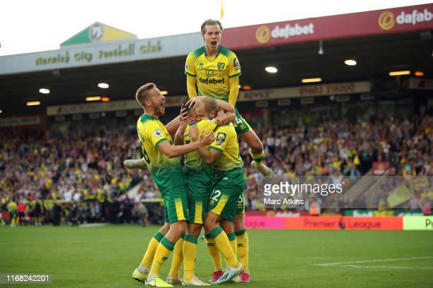 Teemu Pukki of Norwich City celebrates with team mates after scoring their 3rd goal during the Premier League match between Norwich City and...