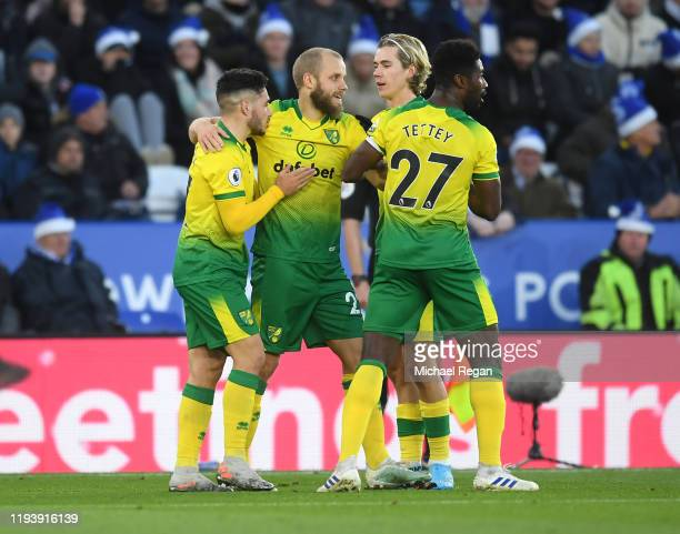 Teemu Pukki of Norwich City celebrates with team mates after scoring his team's first goal during the Premier League match between Leicester City and...