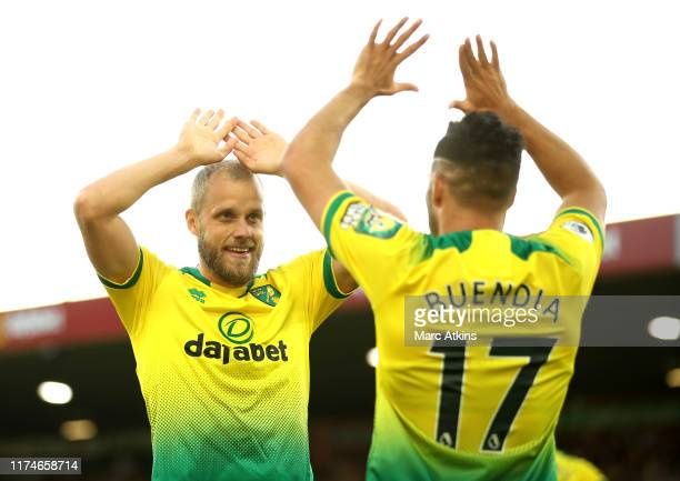 Teemu Pukki of Norwich City celebrates with teammate Emiliano Buendia of Norwich City after scoring his team's third goal during the Premier League...