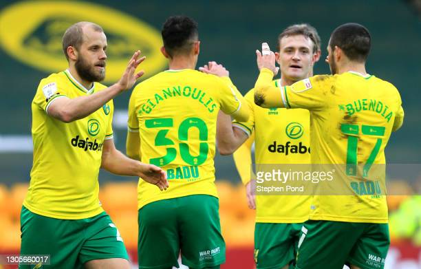 Teemu Pukki of Norwich City celebrates with teammate Emiliano Buendia after scoring his team's second goal during the Sky Bet Championship match...