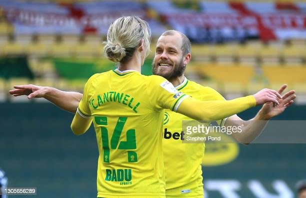 Teemu Pukki of Norwich City celebrates with teammate Todd Cantwell after scoring his team's first goal during the Sky Bet Championship match between...