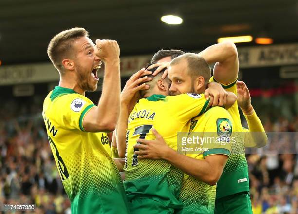 Teemu Pukki of Norwich City celebrates with teammates after scoring his team's third goal during the Premier League match between Norwich City and...