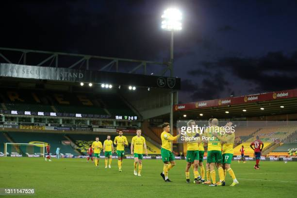 Teemu Pukki of Norwich City celebrates with teammates after scoring their team's second goal during the Sky Bet Championship match between Norwich...