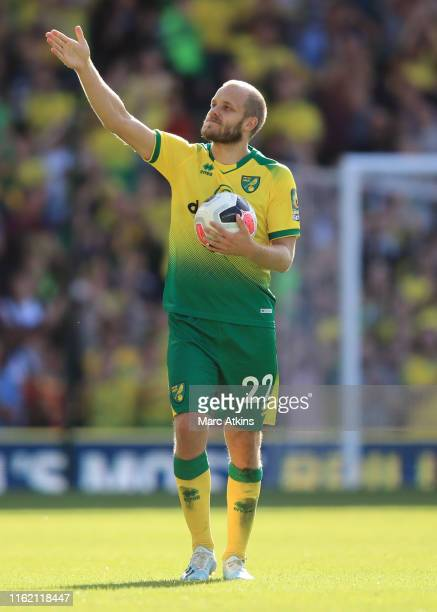 Teemu Pukki of Norwich City celebrates with the match ball after his hat trick during the Premier League match between Norwich City and Newcastle...