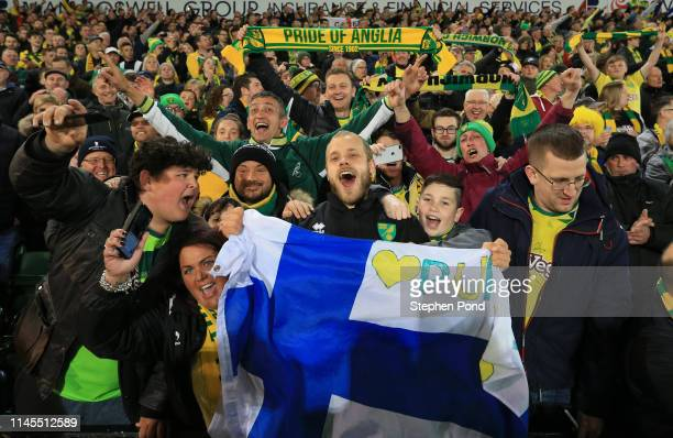 Teemu Pukki of Norwich City celebrates with their fans as his team secure promotion to the Premier League following their victory in the Sky Bet...