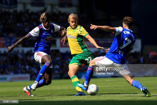 Teemu Pukki of Norwich City is blocked by Trevoh Chalobah and Gwion Edwards of Ipswich Town during the Sky Bet Championship match between Ipswich...