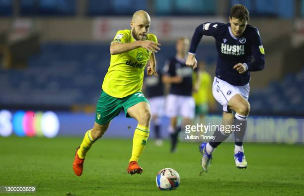 Teemu Pukki of Norwich City is put under pressure by Jake Cooper of Millwall fc during the Sky Bet Championship match between Millwall and Norwich...
