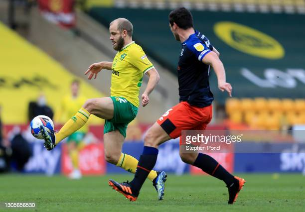 Teemu Pukki of Norwich City is put under pressure by Matty Pearson of Luton Town during the Sky Bet Championship match between Norwich City and Luton...