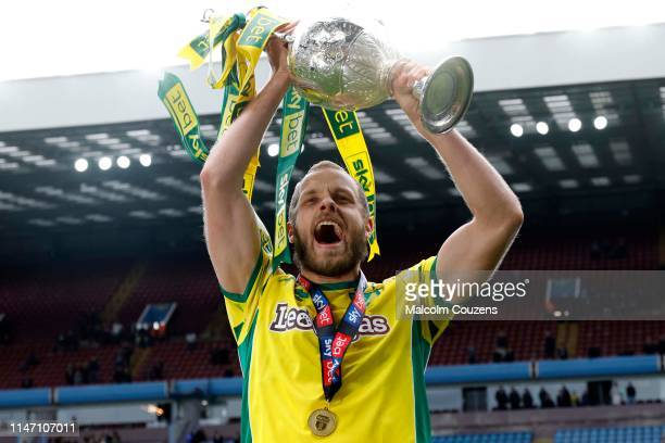 Teemu Pukki of Norwich City lifts the Championship trophy following the Sky Bet Championship game between Aston Villa and Norwich City at Villa Park...