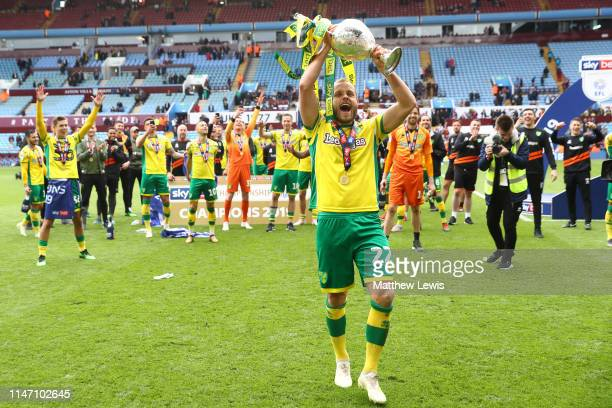 Teemu Pukki of Norwich City lifts the championship trophy in celebration after the Sky Bet Championship match between Aston Villa and Norwich City at...