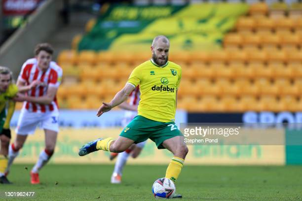Teemu Pukki of Norwich City scores a penalty for his team's fourth goal during the Sky Bet Championship match between Norwich City and Stoke City at...