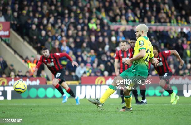 Teemu Pukki of Norwich City scores his sides first goal from the penalty spot during the Premier League match between Norwich City and AFC...
