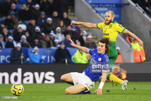 Teemu Pukki of Norwich City scores his team's first goal past Caglar Soyuncu of Leicester City during the Premier League match between Leicester City...