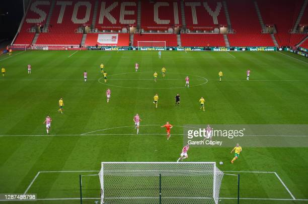 Teemu Pukki of Norwich City scores their team's third goal during the Sky Bet Championship match between Stoke City and Norwich City at Bet365...