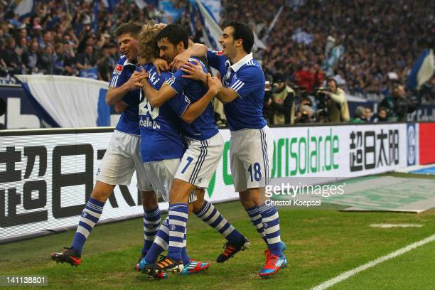 Teemu Pukki of Schalke celebrates the first goal with KlaasJan Huntelaar Raul Gonzalez and Jose Manuel Jurado of Schalke during the Bundesliga match...