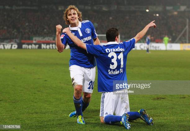 Teemu Pukki of Schalke celebrates with his team mate Julian Draxler after scoring his team's second goal during the Bundesliga match between Hannover...