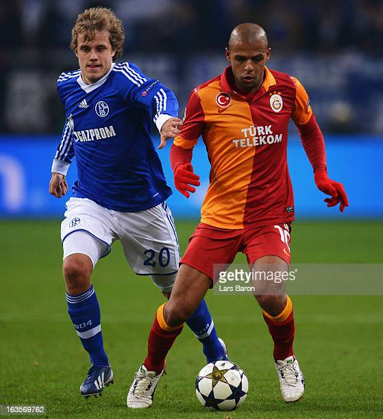 Teemu Pukki of Schalke challenges Felipe Melo of Galatasaray during the UEFA Champions League round of 16 second leg match between FC Schalke 04 and...