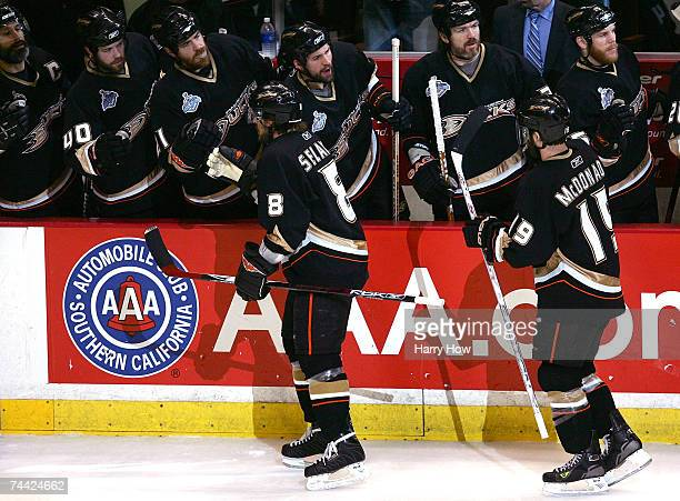 Teemu Selanne and Andy McDonald of the Anaheim Ducks are congratulated by teammates after McDonald scored on a powerplay in the first period against...