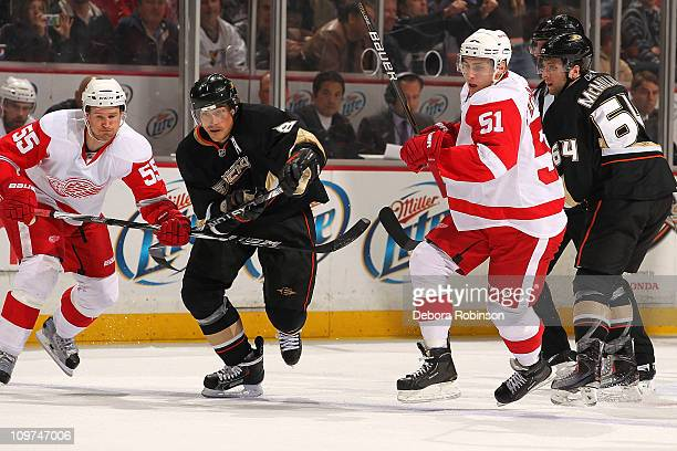 Teemu Selanne and Brandon McMillan of the Anaheim Ducks battle against Valtteri Filppula and Niklas Kronwall of the Detroit Red Wings during the game...