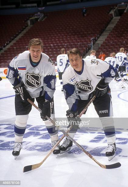 Teemu Selanne and Dmitri Mironov of the World and Mighty Ducks of Anaheim pose for a portrait before the 1998 48th NHL All-Star Game against North...