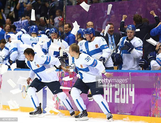 Teemu Selanne and Jussi Jokinen of Finland celebrate with teammates after defeating the United States 5-0 during the Men's Ice Hockey Bronze Medal...