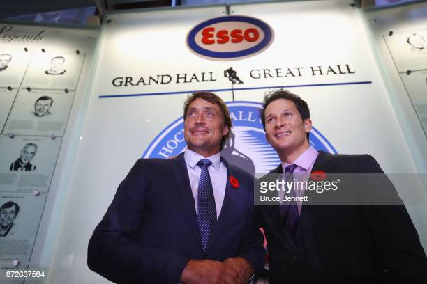 Teemu Selanne and Paul Kariya pose for photos during a media opportunity at the Hockey Hall Of Fame and Museum on November 10 2017 in Toronto Canada