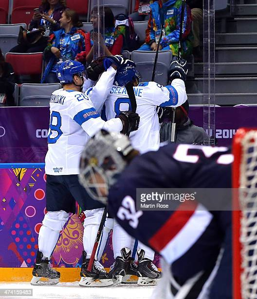 Teemu Selanne of Finland celebrates with Lauri Korpikoski against Jonathan Quick of the United States in the second period during the Men's Ice...