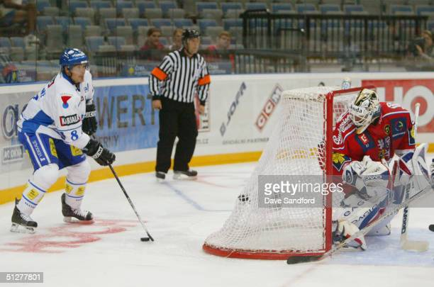 Teemu Selanne of Finland looks to center the puck during an exhibition game of the World Cup of Hockey against the Czech Republic at Sazka Arena on...