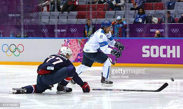 Teemu Selanne of Finland shoots and scores against Ryan McDonagh of the United States in the second period during the Men's Ice Hockey Bronze Medal...