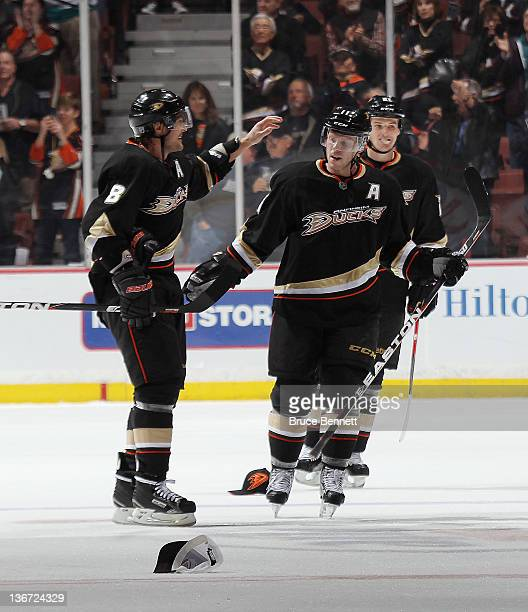 Teemu Selanne of the Anaheim Ducks celebrates along with Saku Koivu as Koivu scores his hat trick goal late in the third period against the Dallas...