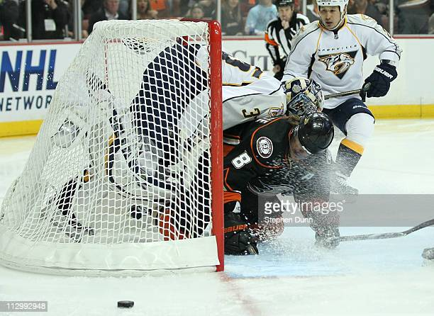 Teemu Selanne of the Anaheim Ducks collides with goalie Pekka Rinne of the Nashville Predators after a Rinne save and both slide into the net in Game...