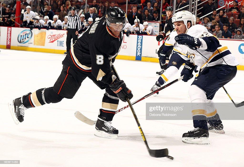 Teemu Selanne #8 of the Anaheim Ducks handles the puck against Scott Hannan #22 of the Nashville Predators on February 27, 2013 at Honda Center in Anaheim, California.